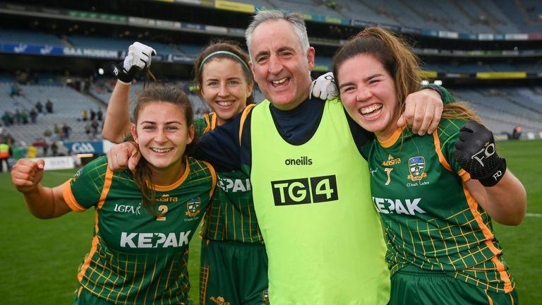Eamonn Murray celebrates with Emma Troy, Niamh O'Sullivan and Shauna Ennis after the match