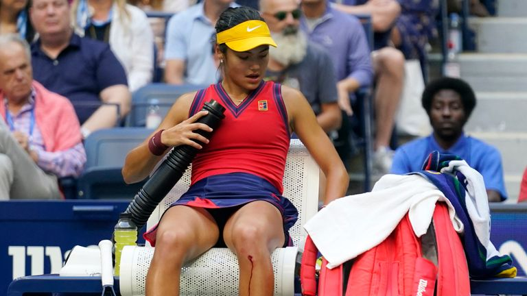 Raducanu overcame a cut to her knee when serving for the match to claim her maiden major (AP Photo/Seth Wenig)  US Open 2021: Emma Raducanu beats Leylah Fernandez to win women's singles title in New York US Open 2021: Emma Raducanu beats Leylah Fernandez to win women's singles title in New York skysports emma raducanu tennis 5509677