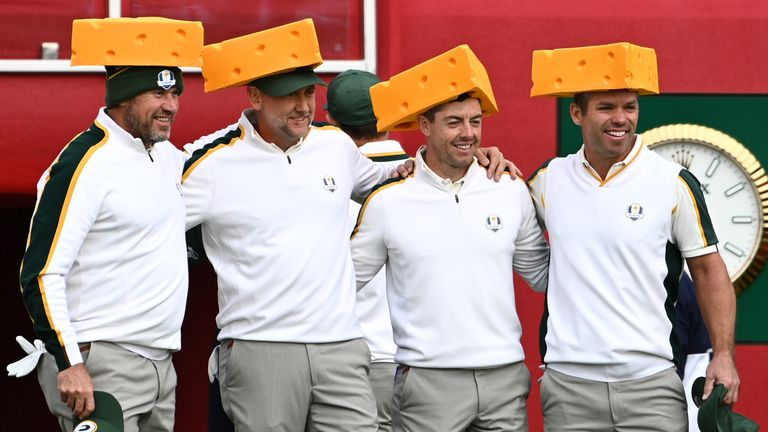Team Europe's Lee Westwood, Ian Poulter, Rory McIlroy and Paul Casey (left-right) arrive on the first tee wearing Green Bay Packers 'cheesehead' hats