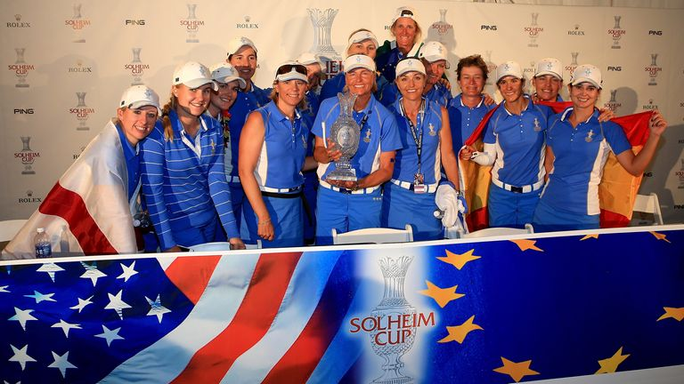 The victorious European team with the trophy at the 2013 Solheim Cup