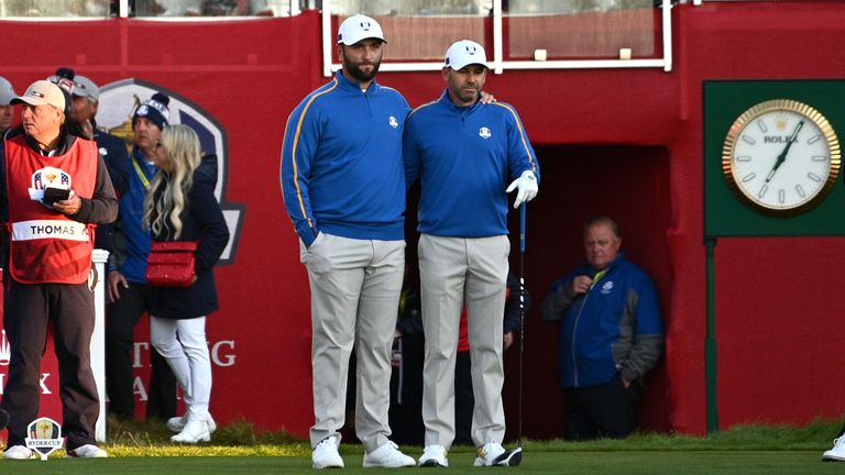 Rahm and Garcia on the first tee in the early-morning Wisconsin sunshine