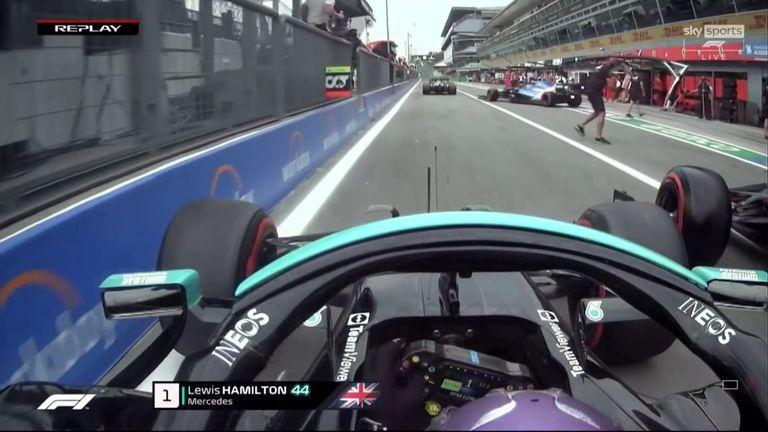 An Alpine team member then blocked Vettel in the pit-lane