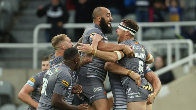 Catalans players celebrate after James Maloney's drop goal clinched victory over St Helens