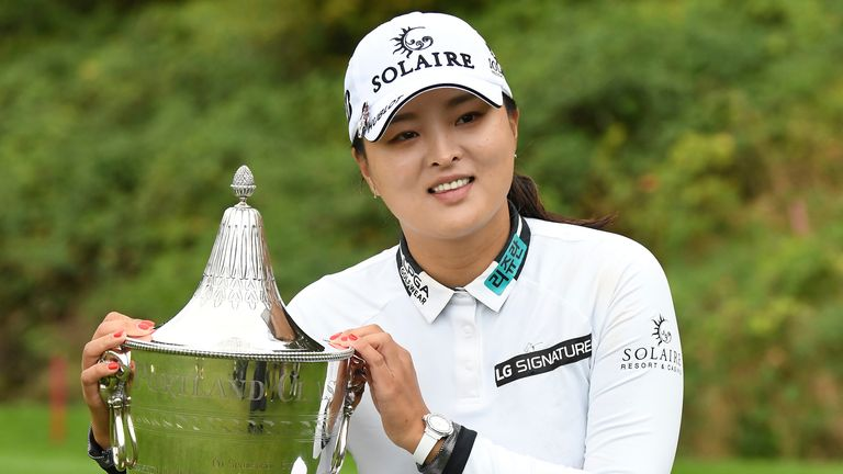 Jin Young Ko poses with the trophy