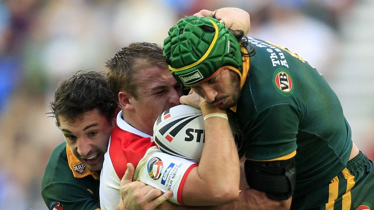 Shenton is tackled when playing for England by Australia's Johnathan Thurston and Billy Slater