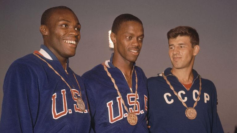 Boston (centre) with his gold medal at the Rome Summer Olympics in 1960 alongside Bo Roberson (left) and Igor Ter-Ovanesyan