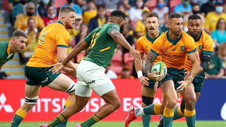 Quade Cooper runs with the ball for the Wallabies