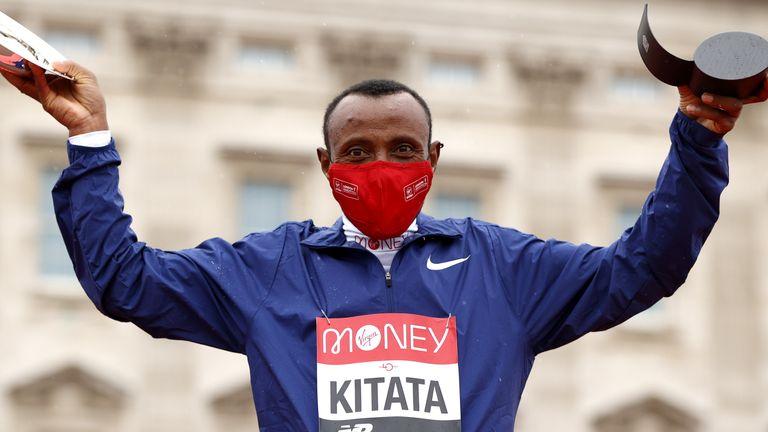 Ethiopia's Shura Kitata celebrates on the podium after winning the  2020 London Marathon.