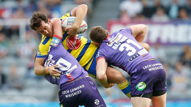 Stefan Ratchford is tackled by Harry Smith and Jackson Hastings
