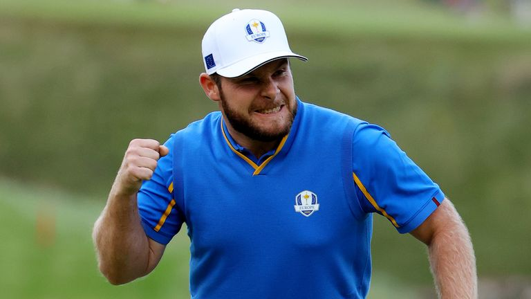 Hatton celebrates after holing his putt on the 18th