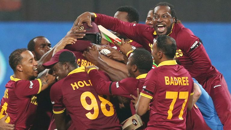 Carlos Brathwaite is mobbed by his West Indies team-mates after striking four sixes in a row to win the 2016 title